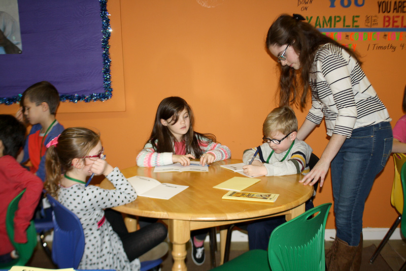 children sitting at a table learning